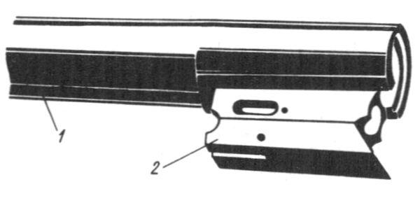 Казенная часть одноствольного ружья: 1 — ствол; 2 — подствольный крюк.